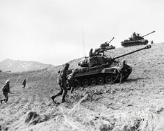 KOREAN WAR: INFANTRYMEN. American Infantrymen supported by tanks advance up a hill in Korea, 1952.