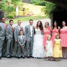coral and gray combo white vest on the groom coral ties on groomsmen