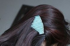 Glue turquoise beads in various lengths to a barrette for a spikey effect. | 31 Impossibly Pretty DIY Hair Accessories