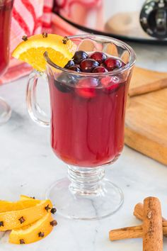 This Spiked Wassail is the perfect holiday punch. It combines juice, sugar, cinnamon sticks, spices and rum to create a warm, boozy holiday drink you can make right in your slow cooker.