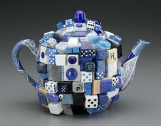sapphire teapot  created by artist Donald Clark  from various bibs and bobs including foil, dice,  awesome game pieces, rings and faux jewels.