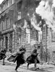 Red Army soldiers rush through the streets of Berlin during the final days, 1945