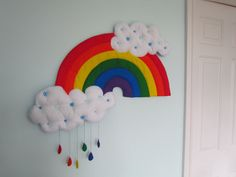 A beautiful rainbow shaped wall hanging that has two stuffed and quilted clouds and some hanging coloured raindrops. This will look adorable on a Mobiles, Rose Nursery, Cloud Shapes, Hanging Hearts, Quilted Wall Hangings, School Holidays, Bedroom Themes, Rainbow Colors, Baby Theme