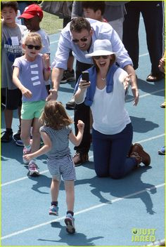 Ben Affleck and Jennifer Garner cheer on their daughter Seraphina, 4, as she runs to the finish line while at a track meet on Sunday afternoon (April 28) in Pacific Palisades, Calif.    The 40-year-old actor and his 41-year-old wife were joined by their oldest daughter Violet, 7, who also took part in the festivities. That morning, the couple took the girls to the Farmers Market.
