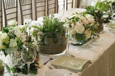 head table with a beautiful floral tablescape. Design by Elegant Details Floral…