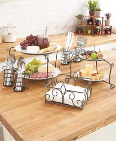 "Serving buffet-style becomes a snap when you use the Ultimate Buffet Organizer. It holds plates, napkins and utensils ready for your guests. It features a 3-tier construction with the bottom for 10-1/2"" dinner plates, the middle for 8-1/4"" salad or desse"