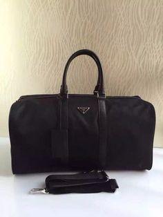Black Prada Tessuto Saffiano Travel Bag sale at USD 299.  Free International Shipping.  More Info on http://www.dfodiscountbags.ch/prada-tessuto-saffiano-travel-bag-pv19s-black