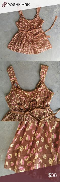 """Anthro Edme & Esyllte Brown Leaf Print Tank Edme & Esyllte tank from Anthropologie, size 6 (small), in excellent condition! Only flaw is one of the bra strap holders needs mending (5th photo). Great combo of brown, pink, and yellow. Has pink hem on inside. Side zipper. Waist tie. 18"""" pit to pit"""" 14.5"""" waist, 24"""" length. 100% cotton. No stretch. Please ask any questions. No trades. Make a reasonable offer. Thanks! Anthropologie Tops Blouses"""