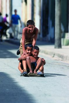 """Cuban boys playing on the streets on a wheelbarrow called commonly """"Chivichana"""". Another Cuban Invention, to solve lack of entertainment for the youth."""