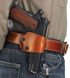 The renowned Yaqui Slide was ushered into the modern era of holster design in 1992 when Galco achieved yet another industry first: adding a set of independent tension screw adjustments, allowing for a custom fit to the firearm and micro-adjustment of 1911 Holster, Pistol Holster, Leather Holster, Leather Tooling, 1911 Pistol, Saddle Leather, Beretta 92, Weapon Storage, Leather Projects
