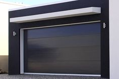 Black insulated panel contemporary garage door. Stainless steel garage door, perfect for contemporary style houses www.garagedoor4less.com