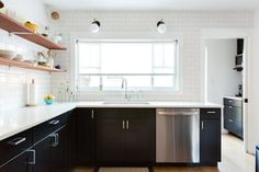 This Austin kitchen is a perfect example of clean and functional minimalism. There isn't a ton going on on the walls, and that's what makes this space so incredibly striking. I did spot one thing on the walls, though — and it made me LOL.