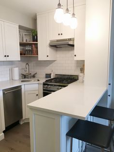 Notice the open shelves + sofit above the corner sink. Clever adjustment to weird space. - Melissa's Manhattan Studio Apartment Makeover — Makeover