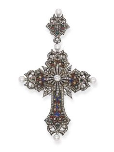 AN ANTIQUE ENAMEL, DIAMOND AND PEARL CROSS PENDANT, BY BOUCHERON   The ornate cross of green, blue and red enamel, diamond scroll and collet detail with central diamond cross motif and pearls at the cardinal points, mounted in silver and gold, circa 1875, 10.5 cm. long  By Boucheron
