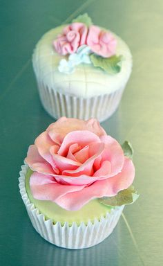 Rose cupcake.  Would be pretty with orange, yellow and pink large roses on them.