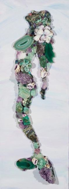 Each one of our gemstone Mosaic Mermaids is a unique one of a kind piece. By ordering an Amethyst-Seafoam Mermaid you will receive one in similar shades of Violet/Seafoam and created with the same materials which include amethyst clusters, crystals & stones, lepidite, amazonite, calcite, fushit... by ines