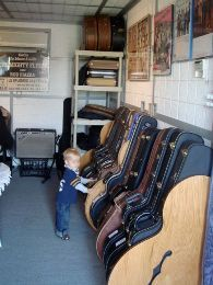 Studio™ Deluxe Guitar Case Rack at this customer's home music studio. More details on this product at http://www.guitarstorage.com/studio-guitar-case-racks/