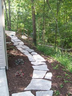 Random flagstones in wooded backyard. Great idea for the sides of my house