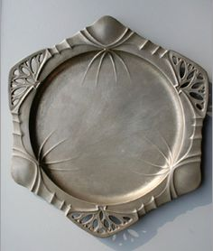Art Nouveau pewter plate, Dutch, stamped URANIA 1202, attributed to Friedrich Adler, 26 cm diam.