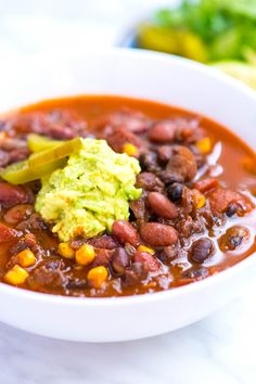 Make this easy vegetarian bean chili recipe with dried beans or canned. It's so flexible you can cook it on the stove or use your slow cooker!