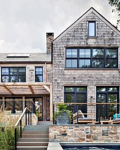 Designed with the Stone Barns in mind, this modern lake house is perfect for all seasons. Source by sambatothesea Modern Lake House, Modern House Design, Farmhouse Style Bedrooms, Modern Farmhouse, Modern Rustic, Stone Barns, Facade House, House Facades, My Dream Home