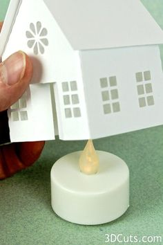 Make your own village from scratch - Ashbee Design Silhouette Projects: Tea Light Village Tutorial Noel Christmas, Christmas Paper, Christmas Ornaments, 3d Cuts, Putz Houses, Paper Houses, Cardboard Houses, Christmas Villages, Silhouette Projects