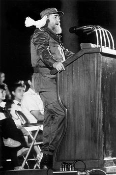 Bird lands on Fidel Castro during a rally. (1959)