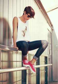 Chilling on a fence, looking hipster, sweet kicks (I own those) swag.