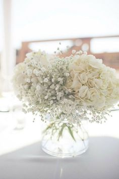 Hydrangeas and baby's breath, centerpieces - beautiful decoration for celebrating the Sacrament of Baptism.