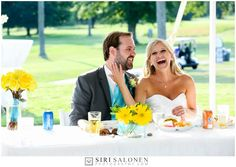 Happy Bride and Groom at the Head Table with Yellow Flowers in Mason Jars Northern Michigan's Premiere Destination Venue-Crystal Lake Weddings.