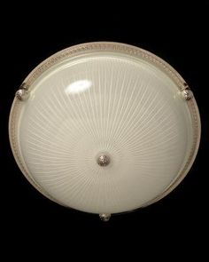 Marvin Alexander,Inc. Nickeled bronze and ribbed glass flushmount with button, three lights.