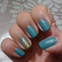 Just to change things up, here's photonof my right hand. The nail polish is showing up blue when it's really a deep teal. Also, I'm still a long way away from doing a decent tape manicure. January 19, 2014 #ManicureMonday #manicure #nails #nailart #nailpolish