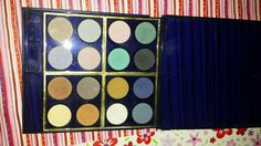 The inside of the Estee Lauder  palette, lightly used, pans are a little bigger the a quarter! Tons of product left.