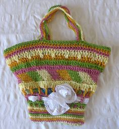 A HANDMADE crocheted BAG MADE OF wool threads in green yellow and pink. HAS TW0 CROCHETED HANDELS. very special pattern with white lace ribbon and flowers. LINED FROM THE INSIDE WITH A NICE COTTON FABRIC AND HAS POCKETS INSIDE . | eBay!