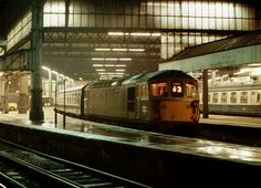 Time for a nice sleepy journey on the last service of the evening to Exeter from Waterloo. Class 33 No. 33 115 awaits the off for the steady 174 mile run on a damp summer night in the late 1970s.