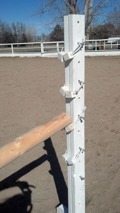 Home Made Jump Cups.  Carriage bolt, wood blocks, rope.  Super cheap and easy!