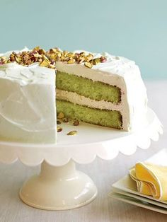 Easy Pistachio Cake - made with a white cake mix, pistachio pudding mix, eggs, veg.oil, 7-Up, milk, Cool Whip and topped with chopped pistachio nuts.  Can't wait to make this!!!