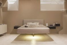Fluttua, the world's first suspended bed. via LAGO STORE Paris