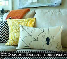 An easy thrifty Halloween décor idea - a DIY Dropcloth Sharpie Pillow for Halloween. I made a pillow cover out of some drop cloth and use a sharpie to sketch and adorable Halloween design.