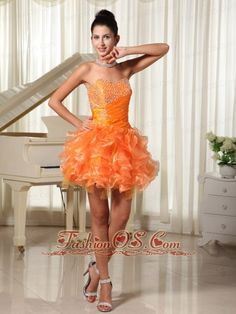 Mini-length Sweetheart Orange Cocktail Dress With Bust Beading and Ruffles  http://www.fashionos.com  Be the belle of the ball in this fabulous orange prom dress includes design of a sweetheart neckline which is generally considered more provocative than other style. You can find that gorgeous beadings and rhinestones decorate the bust which looks charming. Ruching details hug the rest area of the bodice with rhinestones on the side of waist.