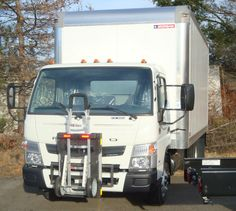 Mitsubishi Fuso Canter F180 delivery truck with Morgan Corporation Truck Body and HTS-10T Hand Truck Sentry System safely securing Liberator hand truck. HTS Systems' commercial delivery equipment is a safe fleet solution.