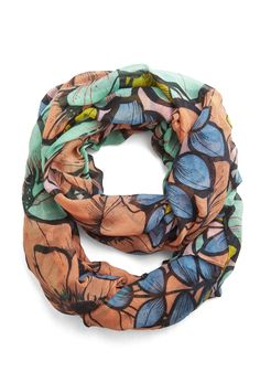 At a Blossom for Words Circle Scarf - Add a fun pop of print and color to any top. Will go with all of the colors in the scarf.