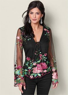 Make a statement in our embroidered mesh top with a floral finesse.