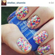 Easy nail art. Just use a toothpick to apply different colored dots. So simple but so cute!