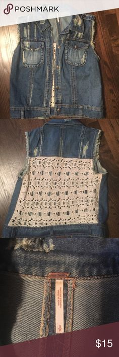 Free People denim & crochet vest size small Free People distressed denim & crochet vest size small with snap front closure & snap front breast pockets. Denim front and crochet back. Super cute! Bought it to wear to a county music concert and then never wore it again. Purchased from Cusp by Neiman Marcus. Like brand new. Free People Jackets & Coats Vests