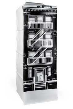 A hanging clothing organizer that looks like a building. | 26 Amazingly Cute Things That Will Also Keep You Organized