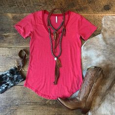 The Hexton pocket tee ~ retro red + leather + cowhide. Cowgirl style. Rodeo fashion. Women's Western Wear. Ranch style. Boho cowgirl. Retro look.