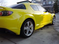 2004 Mazda rx8 GT. Yellow with black leather interior. 6 speed manual transmission. Read spoiler and mazdaspeed kit. Dark tint & rear wheel drive.   Fun to drive in summer, and feels quite light . Cornering is Great due to rear wheel drive and  responsive rotary engine (238 HP)  though massive gas guzzler. And uses high octane fuel(premium)  I feel the previous rotary is a better sports car. The RX7. Can't wait for the next rotary from Mazda.