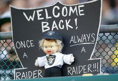 A sign made for NFL broadcaster and former Oakland Raiders head coach Jon Gruden is shown during an NFL preseason football game between the Oakland Raiders and the Dallas Cowboys in Oakland, Calif., Monday, Aug. 13, 2012. (AP Photo/Ben Margot)