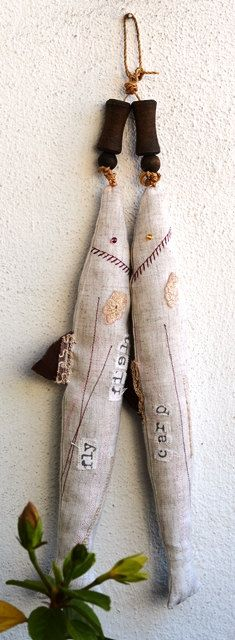 Hanging linen fishes by KeShuni on Etsy, £25.00